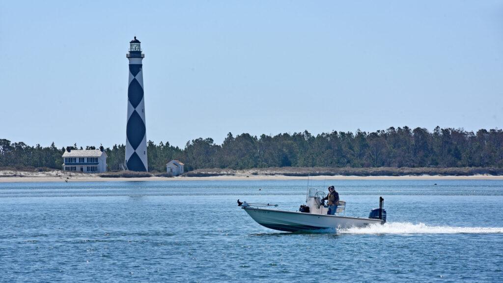 Fishermen zip along the shoreline of Cape Lookout.