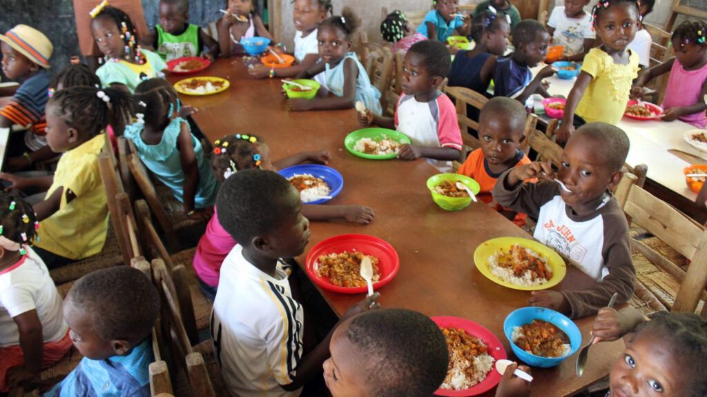 Children eat at a table