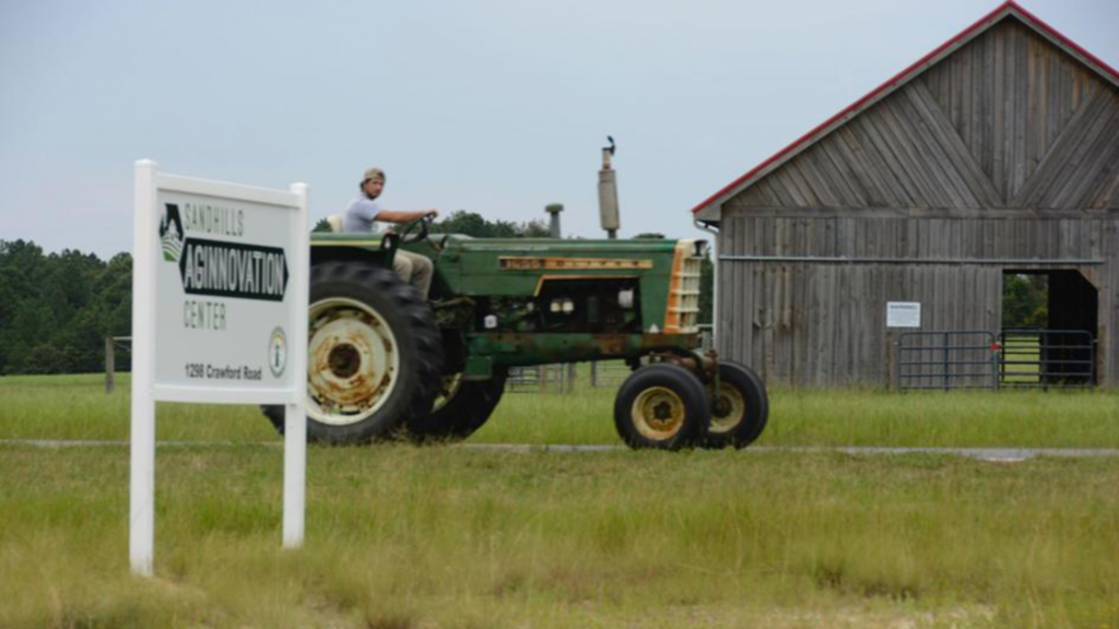 A tractor in the fields at the AgInnovation Center
